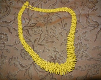 Intricate yellow glass bead necklace