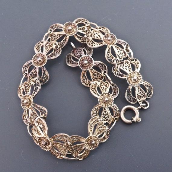 SILVER FILIGREE bracelet . vintage. wire. flower bow  No.001017