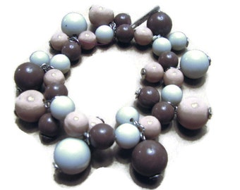 Mocha Chocolate and white  Stretch lucite cha cha bracelet with headpins.