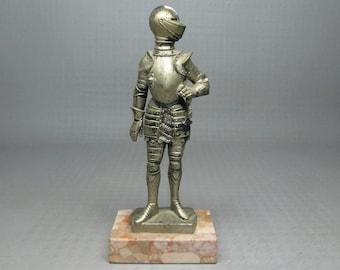 Knight on marble base marked ITALY DEPOSE 1973