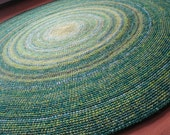 Beautiful area rug in green shades, 50 to 65 inches in diameter, made to order