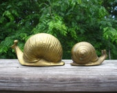 Two Brass Snails