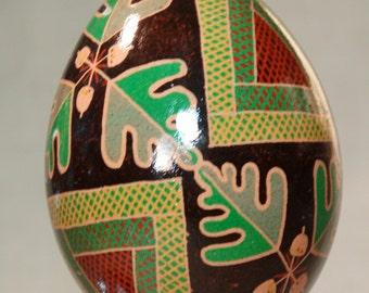 Acorns and Oak leaves pysanka on a brown chicken egg shell