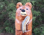 chainsaw carved bear sculpture with fish