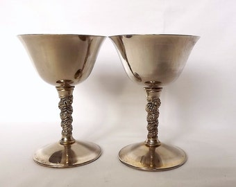 Two silver plated goblets with decorative stems, made by Falstaff