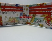 hand made duct tape wallet with comic designs all over it
