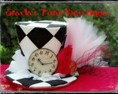 Alice in Wonderland inspired black and white checkered mini top hat with netting