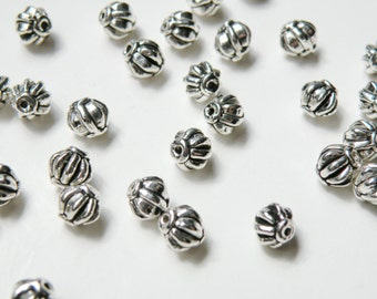 20 Lantern or melon shaped spacer beads antique silver 6mm DB00178