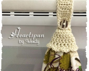 Cream hand or dish towel holder with ruffle skirt, great for holding towels in the kitchen, bathroom, garage, laundry, nursery