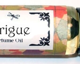 INTRIGUE - Roll on Perfume Oil - 1/3 oz - Ocean / Peach / Green notes