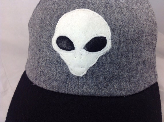 Alien felt logo on wool flannel cap. Available in any size, Fitted with leather sweatband any size.