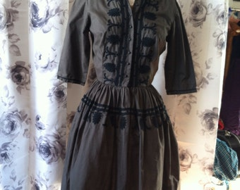 1950 Chocolate brown day dress with black embroidery detail and black buttons