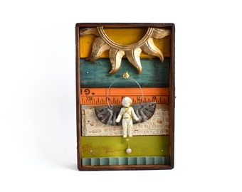 mixed media assemblage art, ICARUS, an original vintage angel art doll ornament, architectural salvage, by Elizabeth Rosen