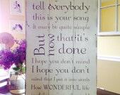 Wedding song lyrics painted on barn wood.