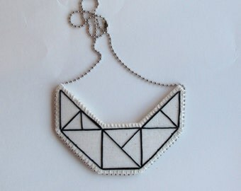 Small embroidered geometric bib necklace on cream muslin with black outline Winter fashion