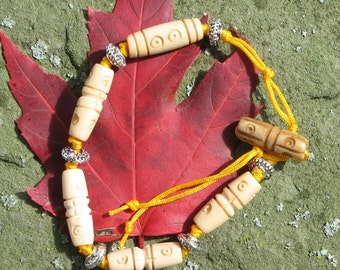 Chinese knotted bracelet with carved bone beads