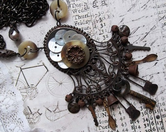Rusty Black, Victorian Frame, MOP buttons and Key and Spoon Charms Necklace