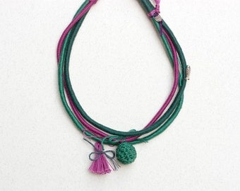 Multistrand fiber necklace, hand wrapped with crochet beads, metal charms and tassel, emerald green pink, OOAK