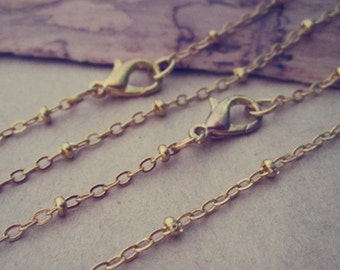 100pcs  2mmx3mm gold color (copper ) Clamp bead  chain necklace with lobster clasp 30inches