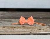 Peach butterfly headband on skinny elastic