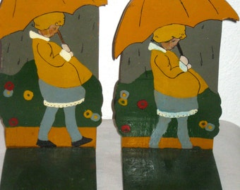 Vintage folk art book ends hand painted hand made cut out wood Morton Salt girl with umbrella