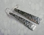 Swirl design long embossed drop earrings silver aluminium