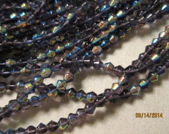 """4x4mm Double Cones, Glass Beads, Violet AB - Available in Small Pkgs of 2 (14"""") Strands & in Larger Multi-Strand Pkgs"""