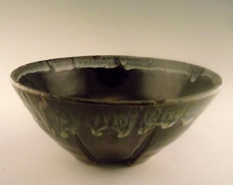 Back to black - Shiny  black tenmoku bowl dripping white rim, with a shaped and cut elegant foot