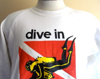 vintage 80's Dive in Bahamas white travel souvenir graphic sweatshirt raglan sleeve fleece crew neck pullover jumper red black yellow logo