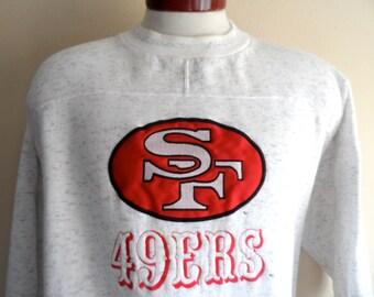 vintage 90's San Francisco 49'ers NFL Football sports team embroidered applique logo graphic sweatshirt white heather grey fleece pullover