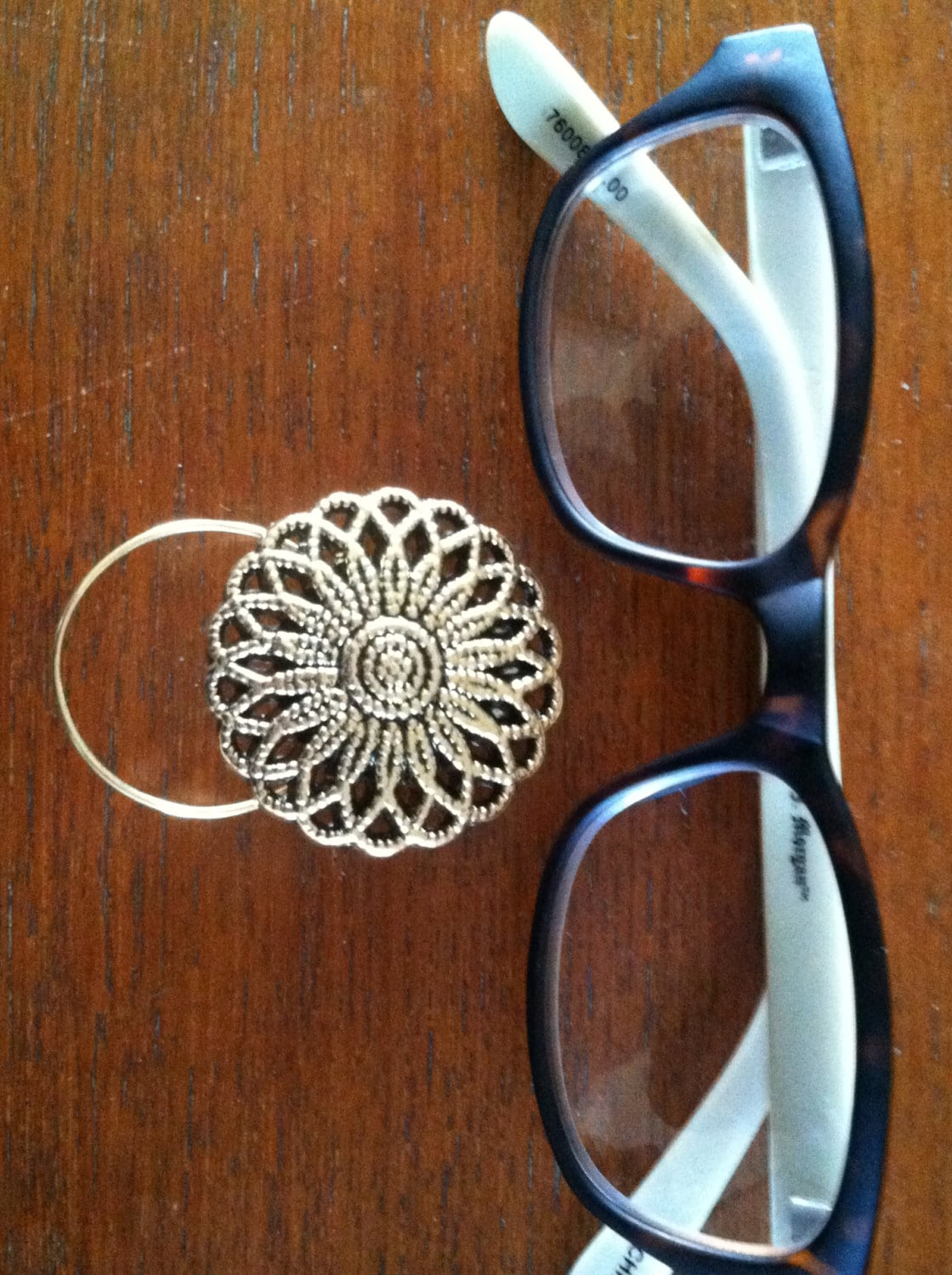 the mattie gold tone flower magnetic eyeglass holder is a