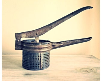 Vintage kitchen ricer strainer / press / antique kitchen supplies / vintage tomato press / metal ricer / antique kitchen
