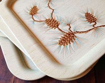Set of Four Vintage Metal Tin Trays with Graphic Pinecone Motif