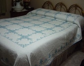 Regular or Queen - size cross stitch quilt, approx. 82x92 inches, all hand quilted.