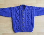 handknitted aran style cardigan to fit age 1to2 years in blue