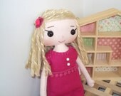 Rag doll with raspberry pearl dress. Can be personalised