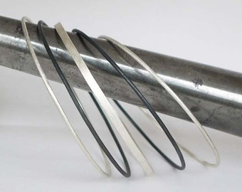 Silver bangle bracelet set of 5- Skinny stacking bangles made of sterling silver and oxidized silver.