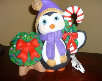 Handpainted Ceramic penquin with lited wreath