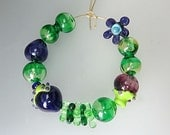 RESERVED - Set of big hollow lampwork glass in violet, greens, amethyst beads by Milica Bubanja SRA