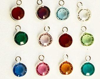 Set of bezel set Swarovski Crystal birthstones. Silver tone. Single ring.