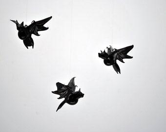 e38-003 Small Bat in Flight