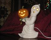"Halloween, Ceramic Running ghost carrying a pumpkin hand painted by Joan Davis, 12"" tall"