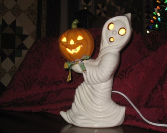 "Halloween, Ceramic Running ghost carrying a pumpkin hand painted by Joan Davis, 12"" tall"