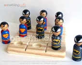 Superman and Batman inspired wooden peg doll tic tac toe game
