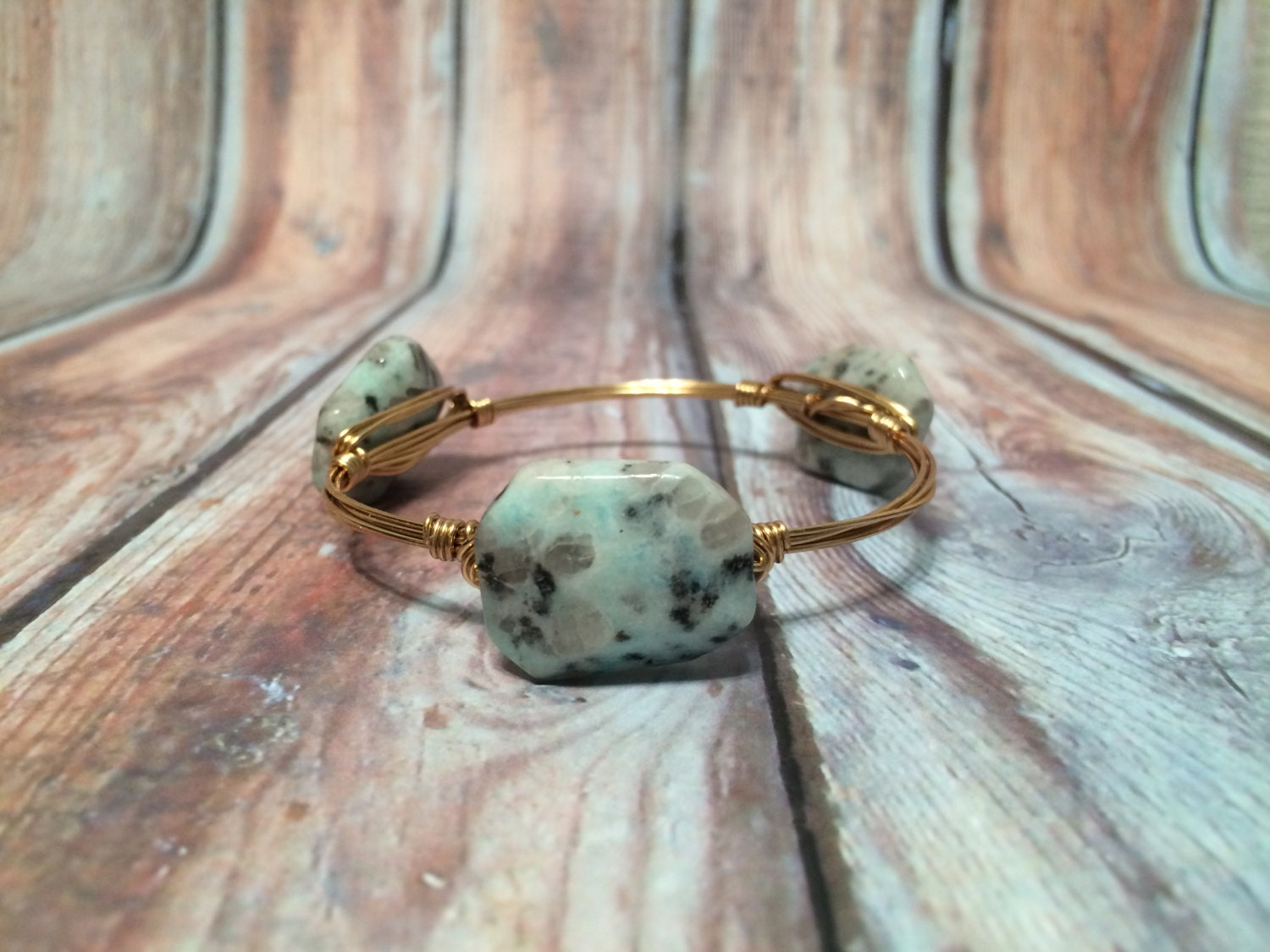 The Sting Ray Grey Speckled Aqua Stone Wire Wrapped Gold Terra And Aqua St Augustine