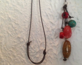 """Long lariat necklace. Adjustable leather to 36"""" large """"cherry"""" Quartz, coral, reconstructed turquoise, and stone bauble."""