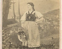Lucerne Switzerland woman in ethnic costume antique cabinet photo