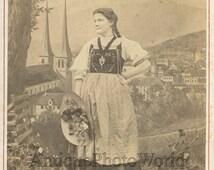 Lucerne Switzerland woman in ethnic costume antique cabinet photo