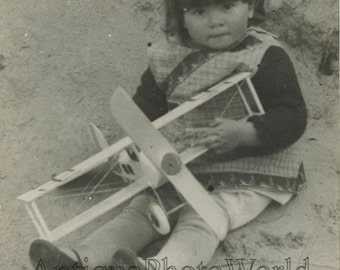 Cute girl with toy airplane antique private photo postcard