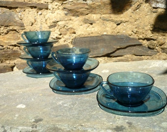 Six French 'vereco' blue glass coffee/espresso/tea cups and saucers